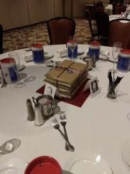Our theme was Walk Down Memory Lane, so these table decorations were meant to remind you of various clubs and activities