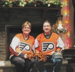 George & I in our hockey jerseys at Thanksgiving in front of our fire place in our new great room
