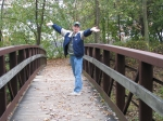 George on the bridge down by towpath across from steel stacks on a fall day.  Taking pics and hiking